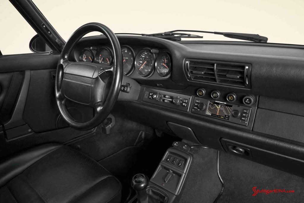 Porsche Classic releases navigation radio: Porsche Classic's new navigation radio is seen here in the dash, from shotgun angle. Credit: Porsche AG