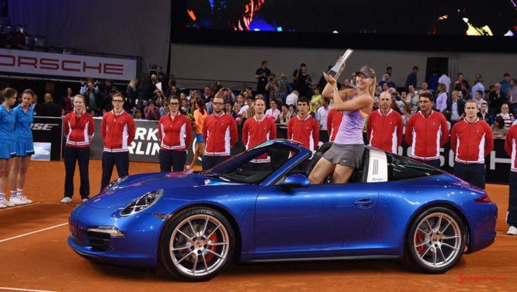 Maria Sharapova 2017 early professional tennis comeback: Maria Sharapova is seen in this photo at the Porsche Arena as Porsche Tennis Grand Prix 2014 winner, standing in a blue 911 Targa. Credit PAG