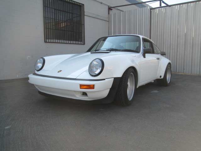 2017 Porsche L.A. Literature, Toy and Memorabilia Meet Weekend: Seen here is a white 911 finished AFTER shot from John Esposito Porsche Repair. Credit: John Esposito Porsche Repair