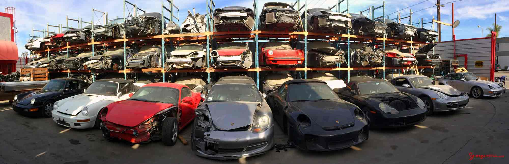 How to choose the best car insurance: LA Dismantler pano of 3 stacked levels of Porsche wrecks in the junkyard. Credit: Los Angeles Dismantler