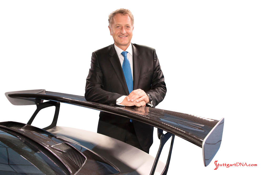 2018 Porsche worldwide record sales: Pictured here in portrait and poised against a carbon-fiber Porsche 911 GT aero wing is a cheery Detlev von Platen, Member of the Executive Board, Sales and Marketing. Credit: Porsche AG