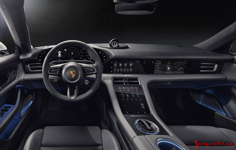 Porsche Taycan first electric sports car world premiere: The Taycan's black-paneled dashboard is seen here with the optional passenger display screen. Credit: Porsche AG