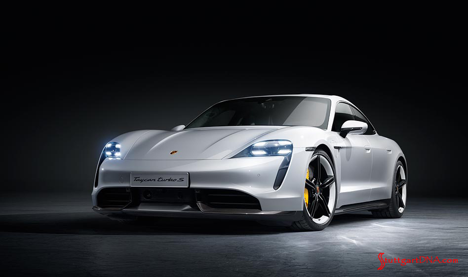 Porsche Taycan first electric sports car world premiere: A white Taycan Turbo S, left-front, is poised under soft, gorgeous lighting in this studio photo. Credit: Porsche AG