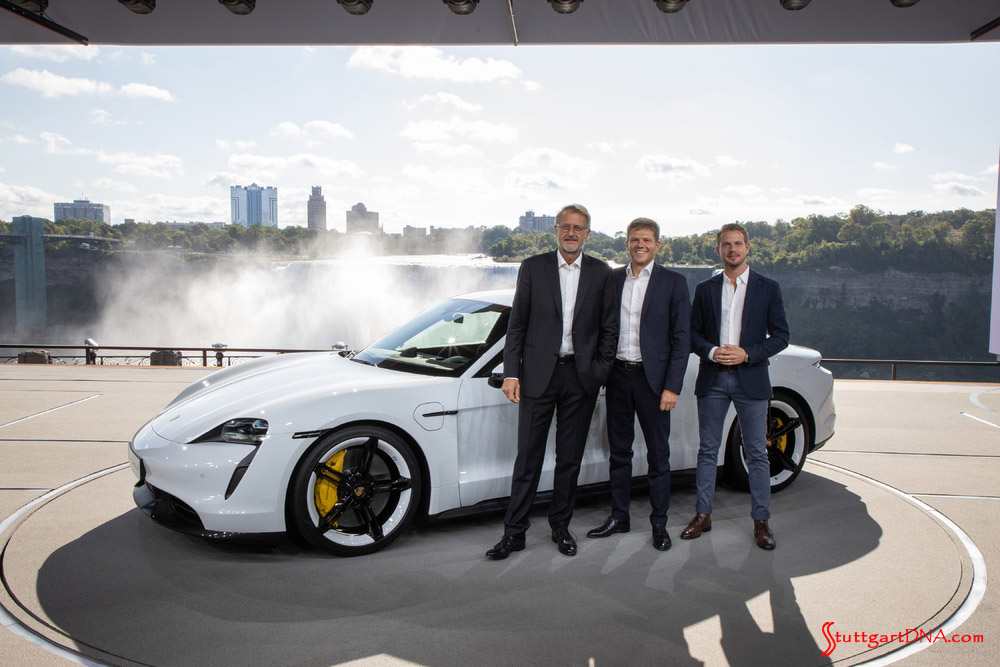 Porsche Taycan first electric sports car world premiere: Seen here is a white Taycan with Porsche executives at the Niagra Falls premiere. From left to right: Detlev von Platen, Member of the Executive Board, Sales and Marketing; Stefan Weckbach, Vice President Product Line Taycan; and Ivo van Hulten, Director Interior-Design, Style Porsche. Credit: Porsche AG